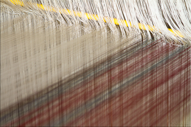 Close-up of silk threads on a large loom
