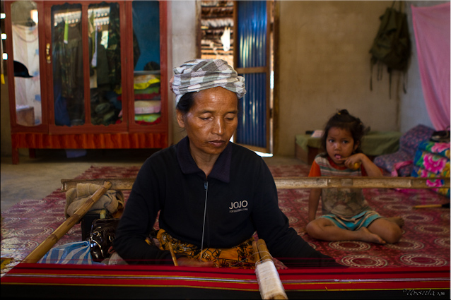 Lao Taliang woman reeling cotton.