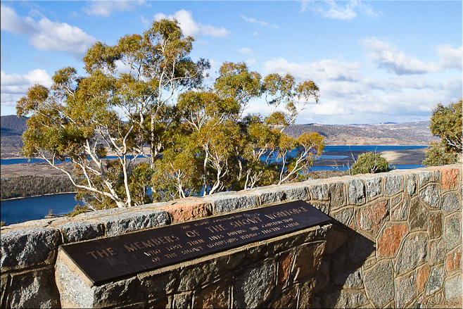 "Plaque: ""The Members of the Snowy Workforce"", agains Lake Jindabyne"