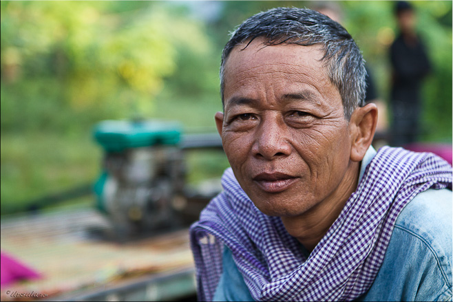 Portrait: Khmer man with norrie motor behind him