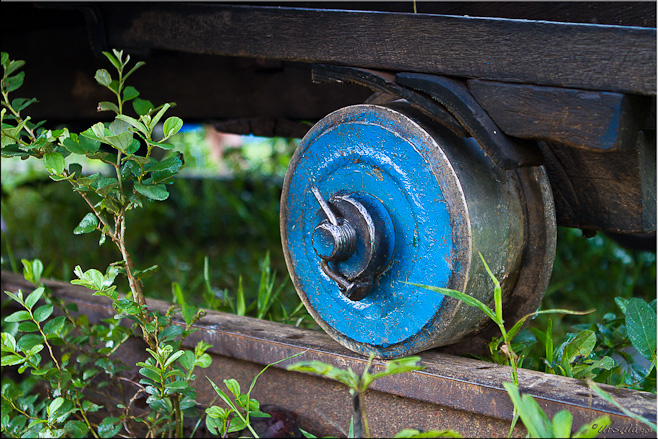 Blue metal wheel on a track