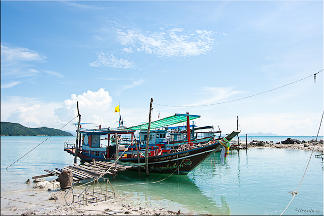 Thai fishing-style tourist boat with a rickety gangplank to the beach