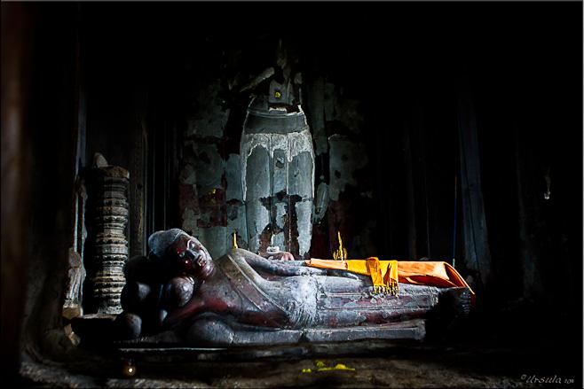 Reclining Buddha in a dark chamber: Angkor Wat