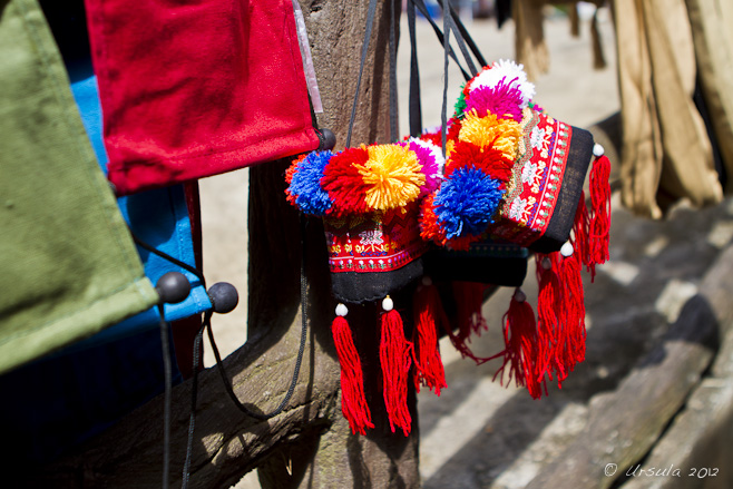 Bags with tassels of red, yellow, blue and white wool.