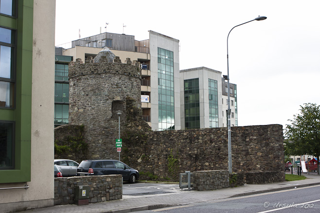 Viking wall-tower against modern buildings