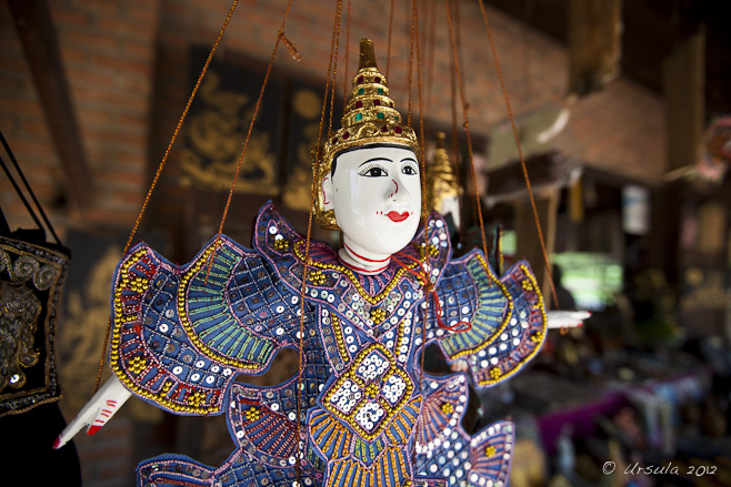 White-faced, delicately painted Thai marionette in sequinned costume