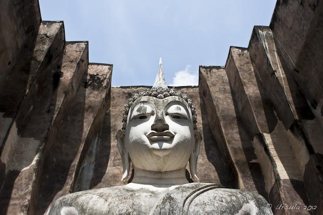 Large white Sukhothai Buddha head.