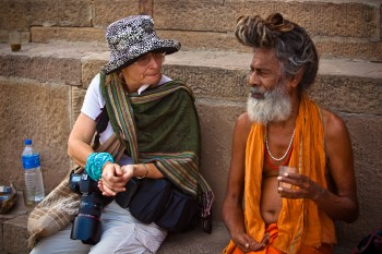 Western woman and Indian sadhu in conversation.
