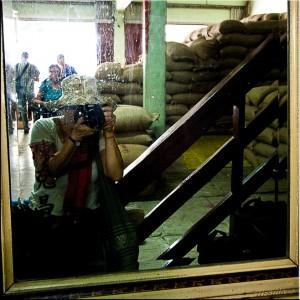 Self-protrait in a peanut warehouse window.