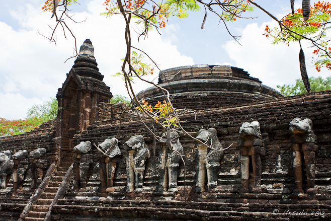 Ceylonese-style temple with Thai elephant carvings.