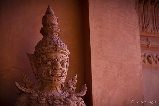 Head shot of a red clay temple-door guardian, Yaak or Dvarapala Yaksha.