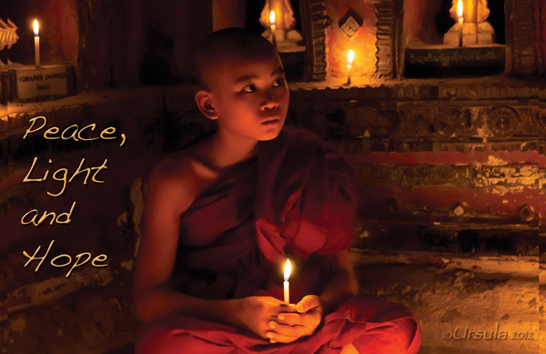Peace Light and Hope: Novice Burmese monk holding a candle in a candle-lit space.