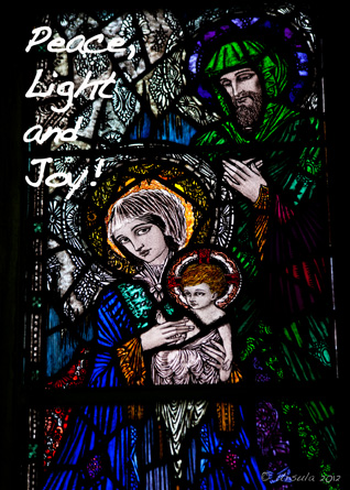 Text: Peace Light and Joy! Picture: Stained glass window of Mary Joseph and Jesus by Harry Clarke.