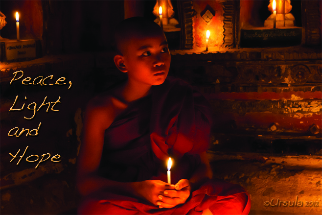 Text: Peace, Love and Light Picture: Young Burmese monk with a candle