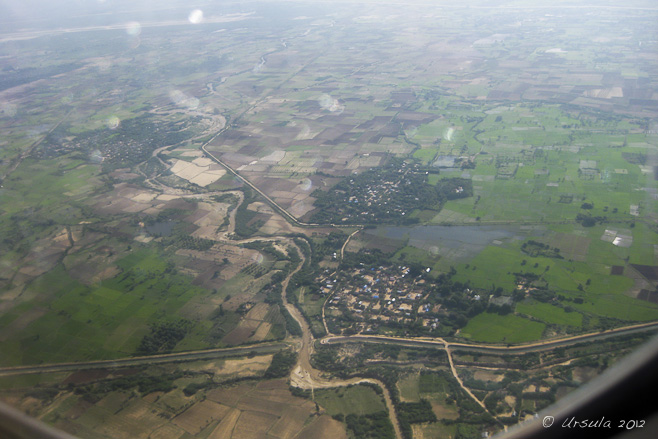 Green fields and muddy river: Aerial view of Mandalay region, Myanmar