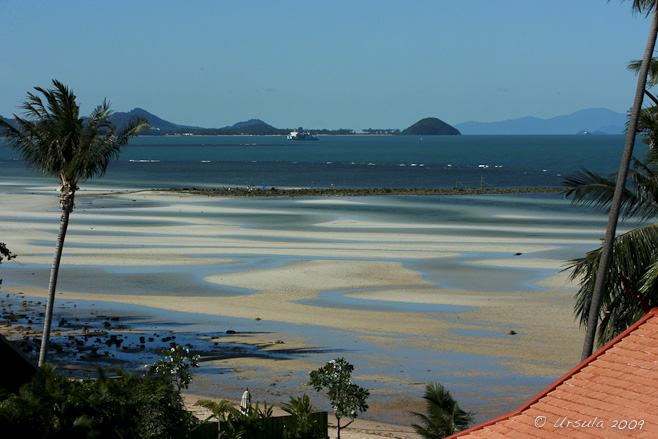 View over sand flats towards Na Thon Pier and Ferry Terminal, Koh Samui, Thailand.