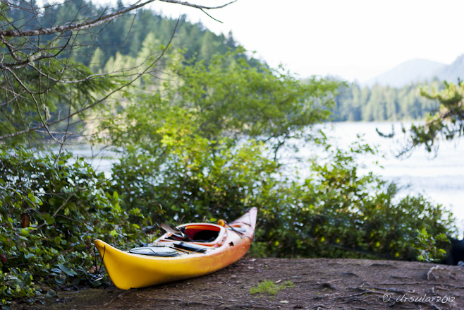Yellow plastic Kayak at Rest on dirt overlooking Skookumchuk Narrows, BC, Canada