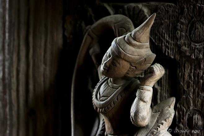 A Buddhist/Hindu Deva carved in bold relief on a teak door, Shwenandaw Kyaung Monastery