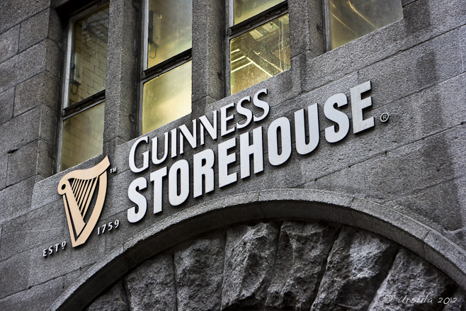 "The harp and ""Guinness Storehouse"" name over a brick archway; Dublin, Ireland."