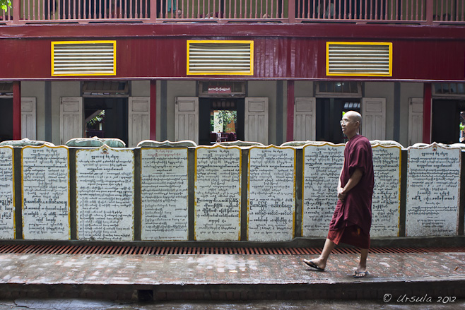 An elder monk walking on the sidewalk, Mahagandayon Monastery