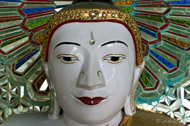 Close-up: white porcelain Buddha head, U Min Thonze Cave, Mandalay, Myanmar