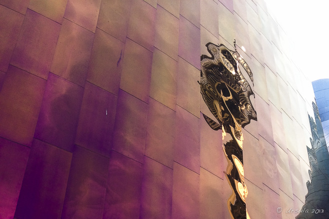 Reflection of a golden Seattle Space Needle in the pink metallic side of the EMP building, Seattle Centre, WA, USA