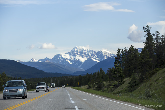 View of mountains, highway and oncoming traffic, Yellowhead Highway, east of Jasper, Alberta.