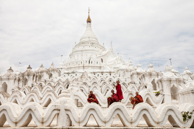 Four novice burmese monks on the lower terraces of Hsinbyume Pagoda, Mingun, Myanmar