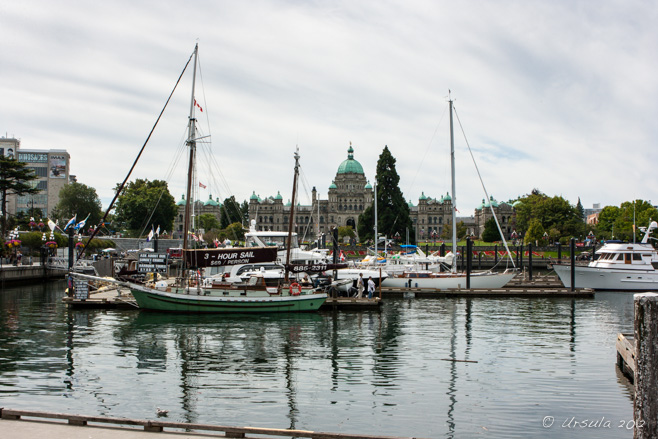 View of Victoria Harbour, sailboats foreground, the British Columbia Legislature Building in the background.