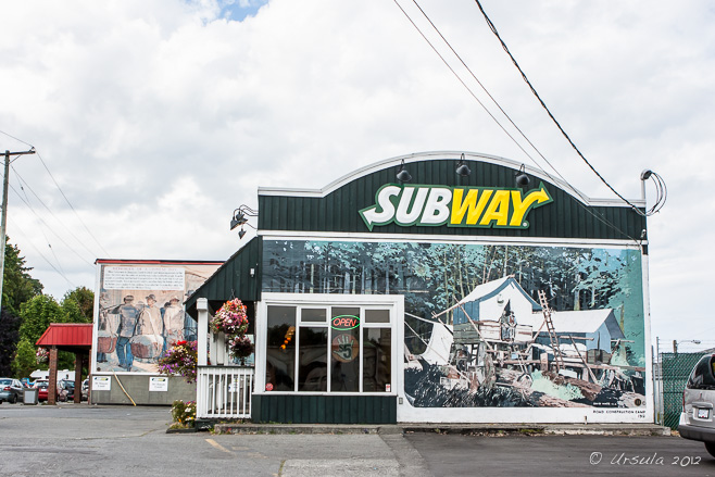 A Subway shopfront painted in with a mural on wooden housing, Chemainus, BC