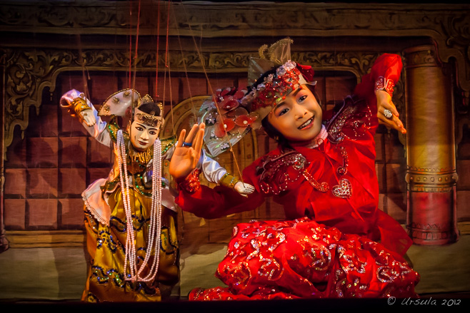 Burmese wooden marionette dancing with a child - Mandalay Marionettes Theatre.