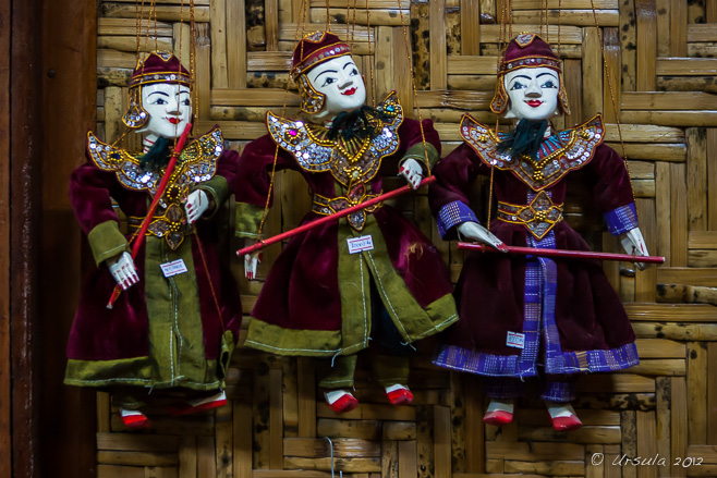 Marionettes for Sale against bambee matting, Mandalay Marionette Theatre