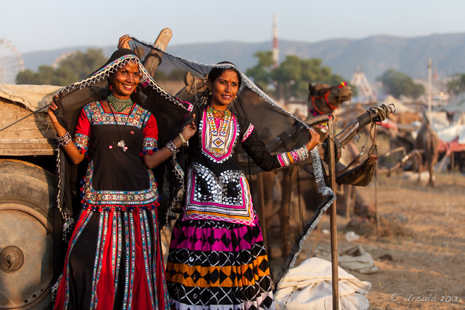 Environmental portrait of two Kalbeliya gypsies in traditional costumes, Pushkar, India.