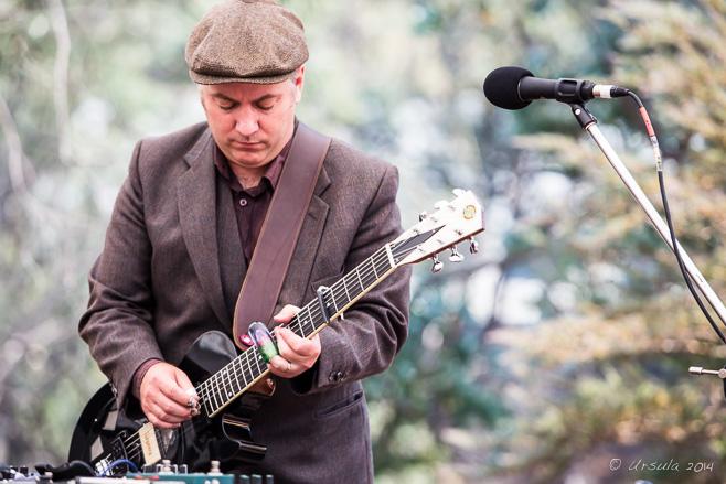 Portrait: Guitarist Jeff Lang playing a black Beltona, Thredbo Australia