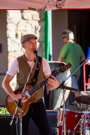 Jimi Hocking  playing in Thredbo Village Square sunshine, Australia