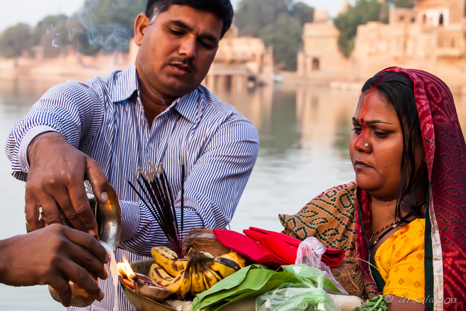 Indian man and woman erforming The Chhath Pūjā, Gadsisar Lake,  Jaisalmer
