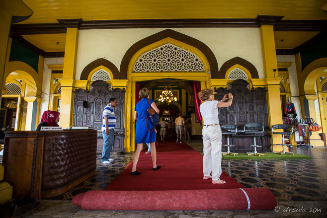 Tourists on the red carpet outside Maimoon Palace, Medan.