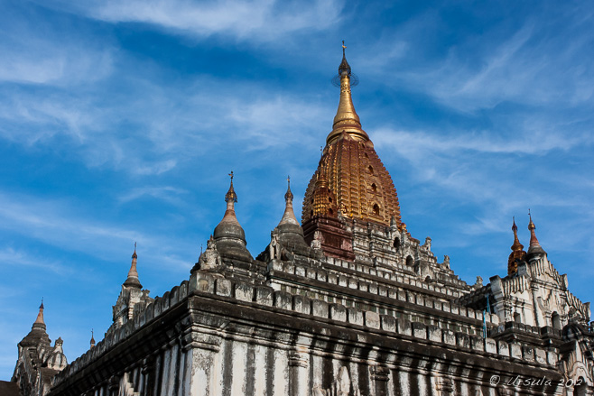 Golden roof of Ananda Temple against a blue sky