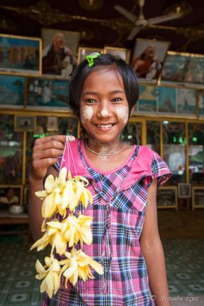 Young burmese girl with flower garlands, Mahagiri Shrine, Mount Popa, Myanmar