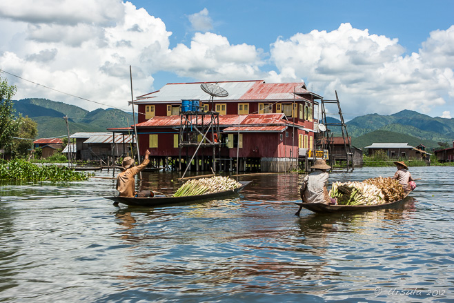 Two wooden boats laden with produce, Inle Lake Myanmar