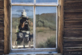 Reflection of a photographer in a wobbly window, Bodie State Historic Park,