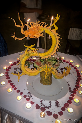 Dragon carved from marrow, Thien Canh Son Cave by candle-light, Bai Tu Long Bay, Vietnam