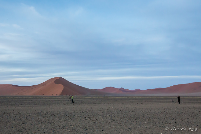 Photographers on the flat ground in front of Dune 40, Namib-Naukluft Park, Namibia