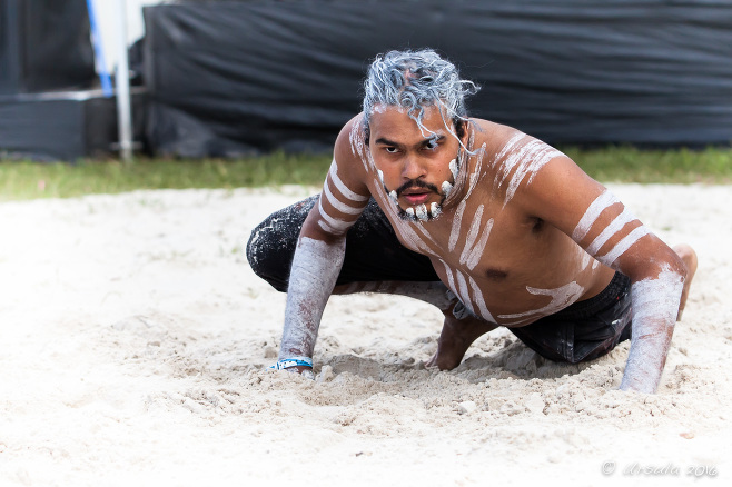 Aboriginal man dancing the dreamtime goanna, Excelsior Dance Troup, Boomerang, Byron Bay Bluesfest 2016 AU