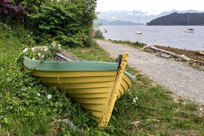 Yellow wooden rowboat on the grass - Gibsons BC
