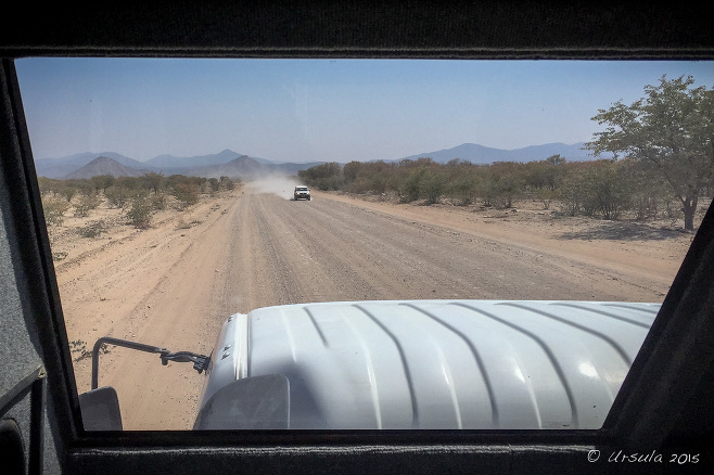 View of a gravel road from a truck window, Kunene Namibia