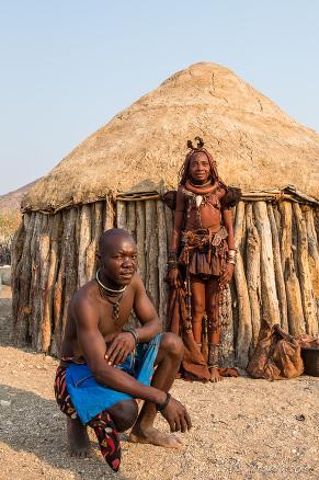 A Himba couple outside their hut, Kunene Region Namibia