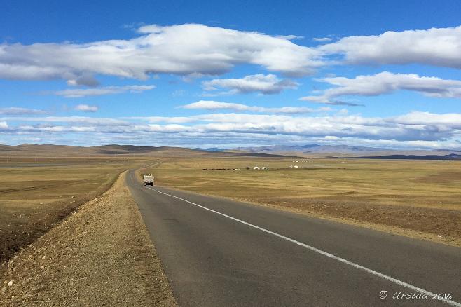 View through a UAZ windscreen: a long Mongolian Roadway
