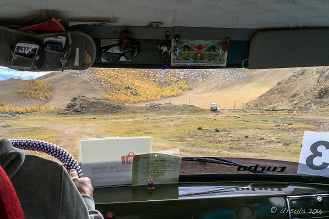 View from a UAZ windshield over dusty hills, Terkhiin Tsagaan Nuur, Mongolia