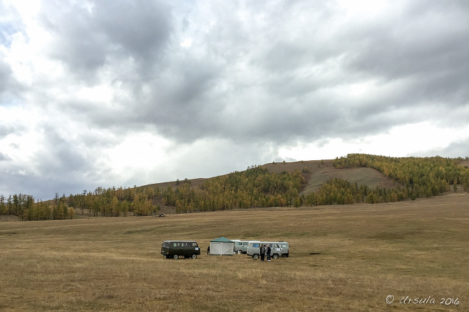UAZ four-wheel drives on the grass, Tarvagatai Mountains National Park, Zavkhan Mongolia